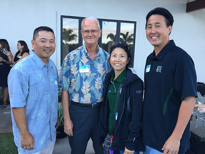 Shidler alumni pictured with Dean Vance Roley