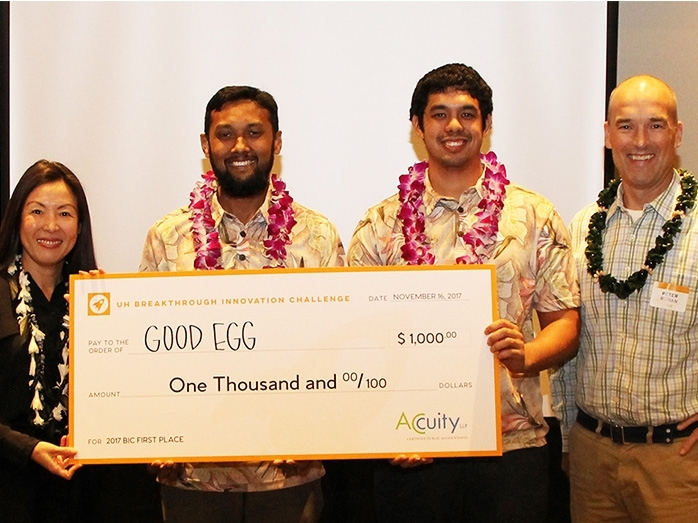 Accuity Consulting Services President Julia Okinaka, Goog Egg team members Arif Rahman and Kainalu Matthews (center) and PACE Executive Director Peter Rowan.