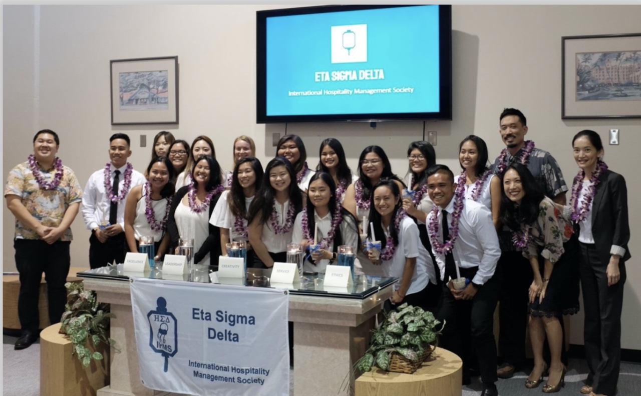 The UH Manoa School of Travel Industry Management honor society Eta Sigma Delta receives Chapter of Distinction Award.