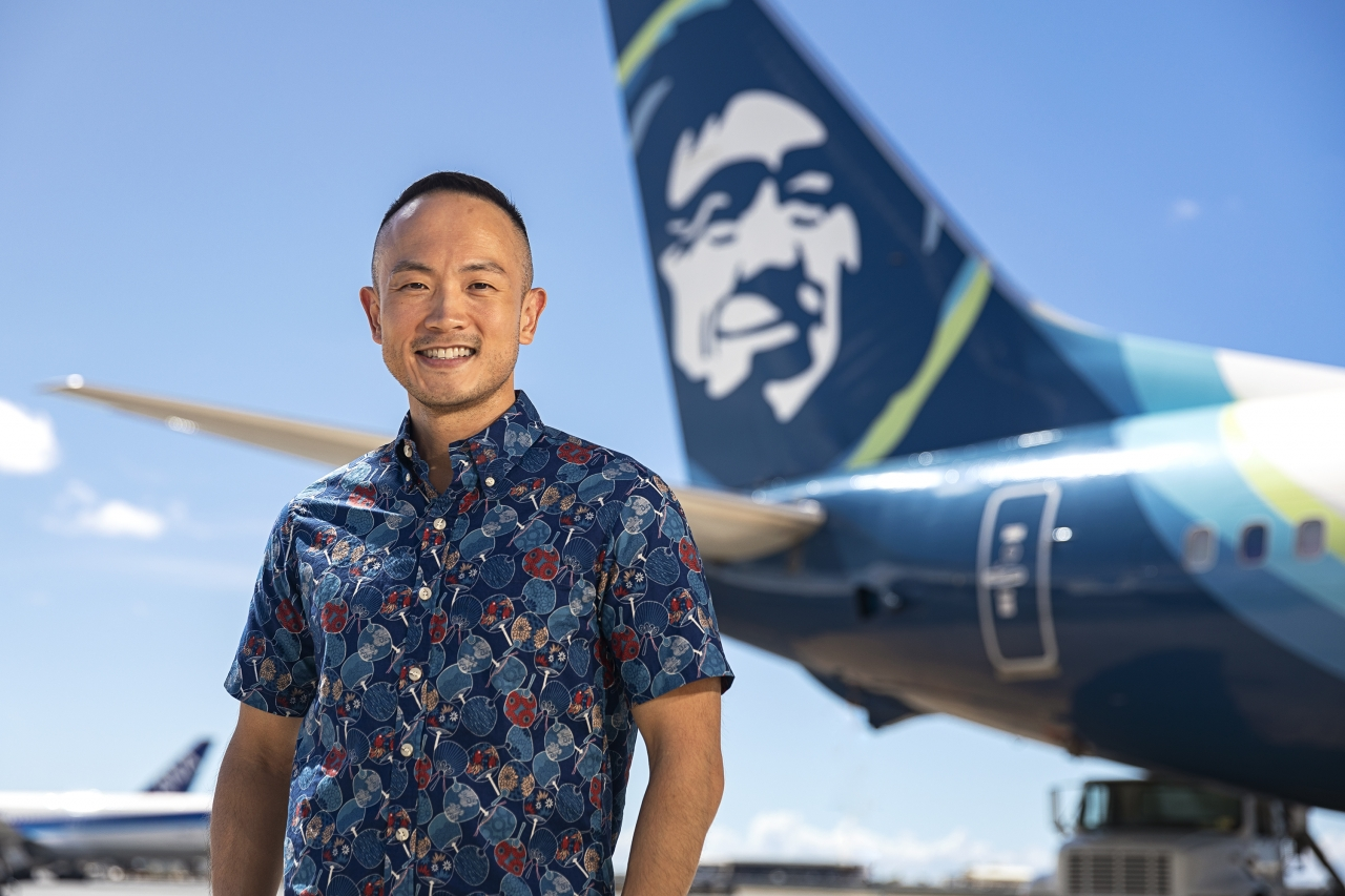 Daniel Chun in front of Alaska Airlines plane